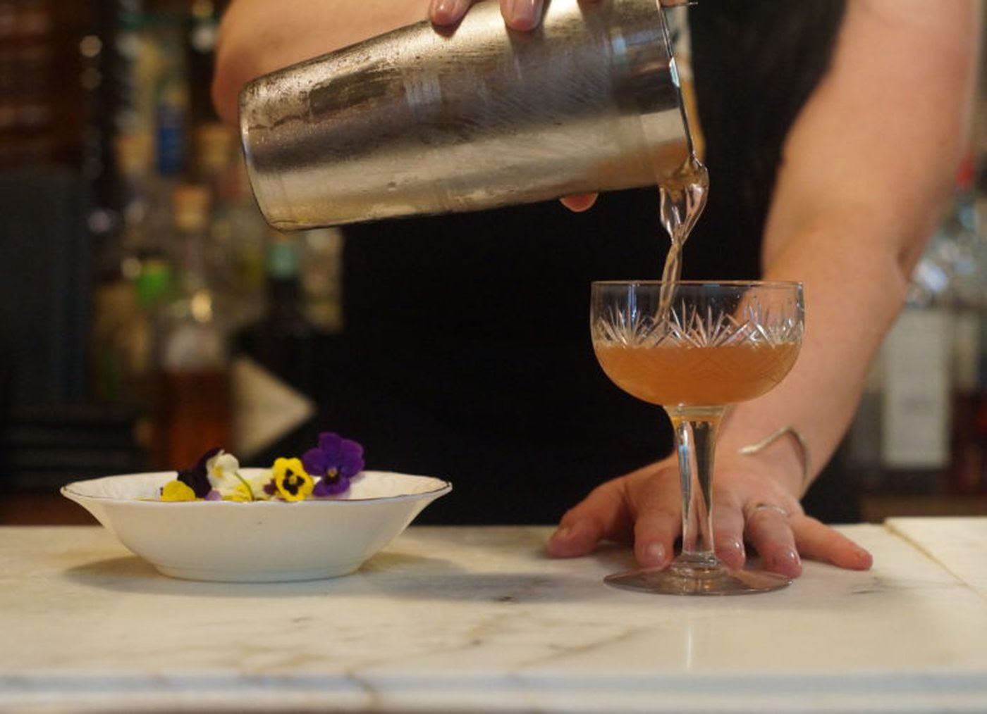 Heather Rodkey, of Rex 1516, Cafe Ynez, and Jet Wine Bar, pours a cocktail.